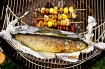 Barbecued trout with mushroom and potato skewers, close-up